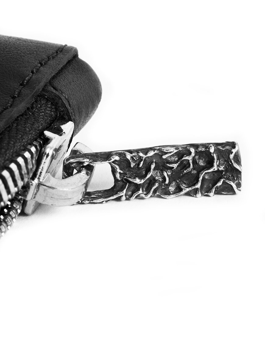 clutch made in italy by superology in collaboration with lucamaleonte