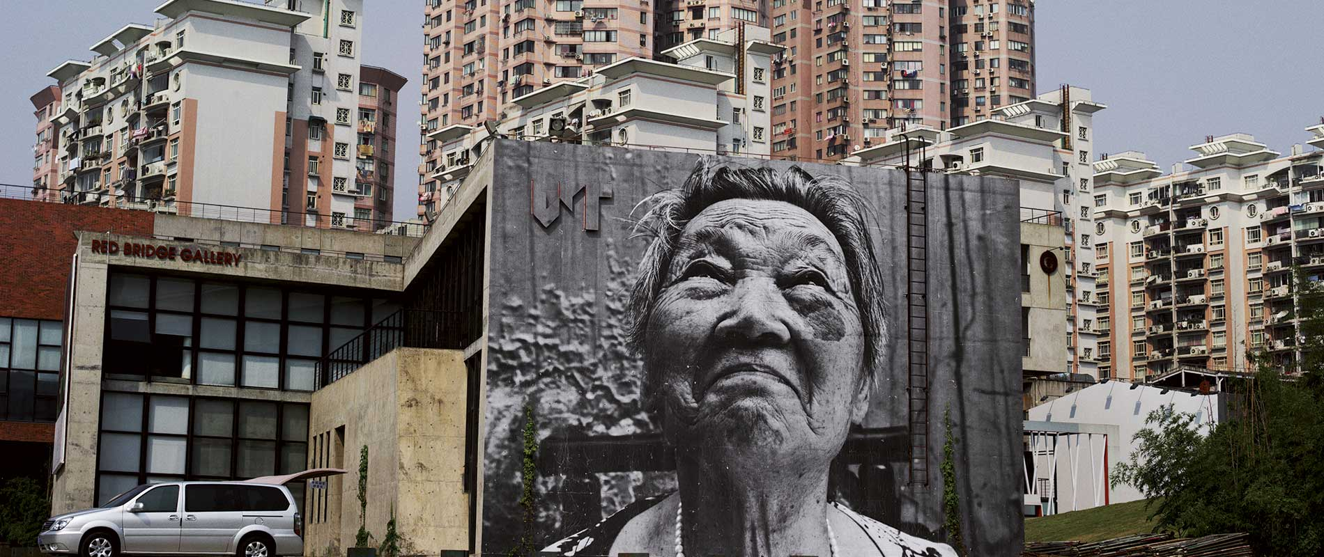 wrinkles portraits on buildings